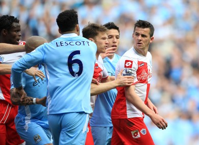 Tempers flare after Queens Park Rangers' Joey Barton clashes with Manchester City's Sergio Aguero.