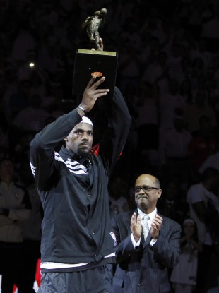 Miami Heat forward LeBron James holds up his NBA MVP trophy.
