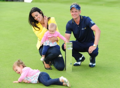 Luke Donald with his wife Diane, and daughters Elle (on floor) and baby Sophia Ann yesterday.