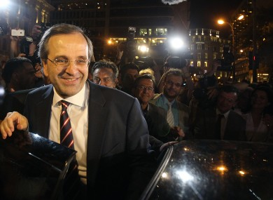 Leader of the New Democracy conservative party Antonis Samaras leaves an elections kiosk after speaking to his supporters at Syntagma square in Athens, Sunday, June 17, 2012