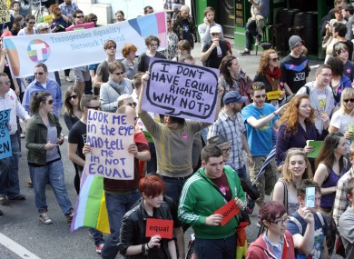 LGBT campaigners marching for civil marriage equality in August last year