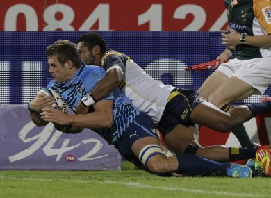 South Africa's Bulls CJ Stander, left, scores a try.