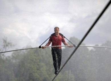 Nik Wallenda performs a walk on a tightrope during a training session in a wind-driven mist at Niagara Falls, New York, on Monday.
