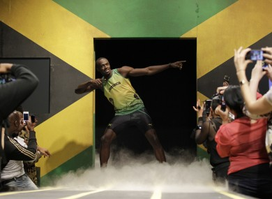Usain Bolt models a Jamaica Olympic kit designed by Cedella Marley, daughter of Bob Marley, during the kit unveiling in London on Friday.