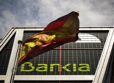 A Spanish flag flies in front of Bankia's headquerters in Madrid