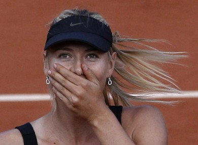 Maria Sharapova reacts as she defeats Petra Kvitova.