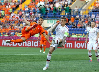 Ibrahim Afellay and Denmark's Daniel Agger (right) in action
