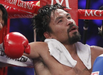 Manny Pacquiao sits in his corner following the eleventh round of his WBO welterweight title fight against Timothy Bradley.