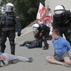 Police arrest soccer fans prior to the Euro 2012 soccer championship Group A match between Poland and Russia in Warsaw, Poland, Tuesday, June 12, 2012. (AP Photo/Gero Breloer)