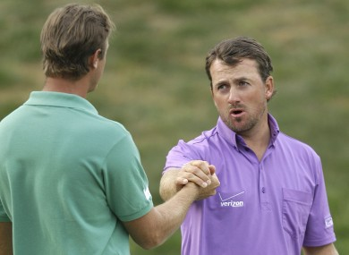 Graeme McDowell shakes hands with shakes hands with Nicolas Colsaerts after the third round.