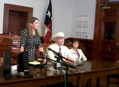From left: DA Heather McMinn speaks at a news conference with Sheriff Micah Harmon and the attorney for the father.