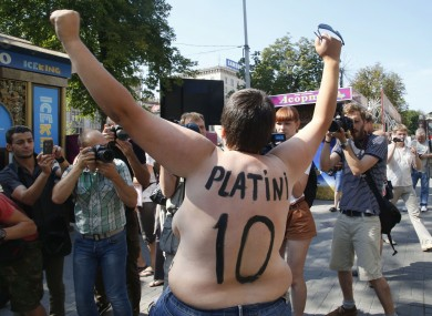 An activist of Ukrainian women movement Femen protests in the Euro 2012 at Fan Zone in Kiev today.