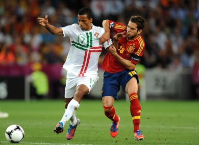 Spain's Ramos Jordi Alba (right) and Portugal's Luis Nani battle for the ball last night.