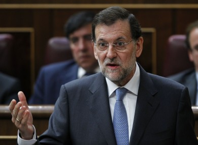 Ministers have approved a €100bn bailout for Spain's banks, while its premier Mariano continues an austerity agenda to close the government's deficit.