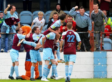 The Drogheda players celebrate.