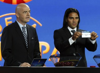 UEFA general secretary Gianni Infantino, left, and Atletico Madrid's Radamel Falcao at this morning's draw in Monaco.