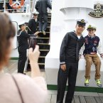 A Sailor from the 'Cuauhtemoc' a Mexican Tall Ship poses for a photo with a young visitor. (Julien Behal/PA Wire)
