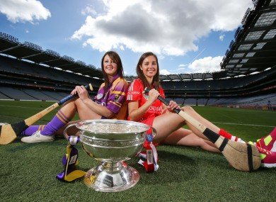 Wexford's Karen Atkinson with Cork's Julia White