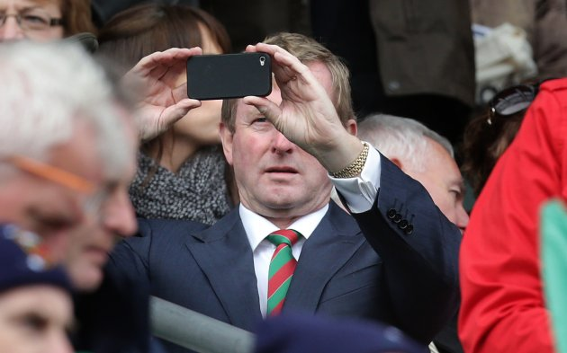 Enda Kenny records the scene on his phone 23/9/2012