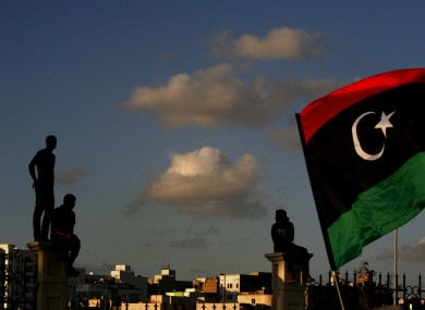 Libyans watch the protest against Ansar al-Shariah Brigades and other Islamic militias, in Benghazi.
