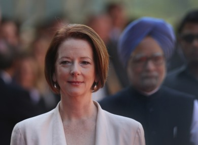Australian Prime Minister Julia Gillard, arrives with her Indian counterpart Manmohan Singh, at the Indian Presidential palace for ceremonial reception, in New Delhi, India , Wednesday, October. 17.