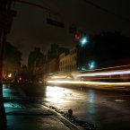 Cars pass through a darkened neighborhood on the west side of Manhattan on Monday in New York. Much of New York was plunged into darkness Monday by a superstorm that overflowed the city's historic waterfront, flooded the financial district and subway tunnels and cut power to hundreds of thousands of people. (AP Photo/Peter Morgan)