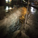 Sea water floods the entrance to the Brooklyn Battery Tunnel on Monday, in New York. Sandy continued on its path Monday, as the storm forced the shutdown of mass transit, schools and financial markets, sending coastal residents fleeing, and threatening a dangerous mix of high winds and soaking rain. (AP Photo/ John Minchillo)
