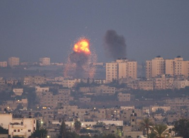 Explosion and smoke rise following an Israeli air strike in the northern Gaza Strip