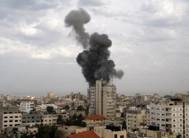 Explosion and smoke rise following an Israeli strike in Gaza City