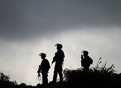 Israeli border policemen stand guard during a protest against Israel's military action on the Gaza Strip in Birzeit