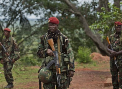 Troops from the Central African Republic stand guard at a building used for joint meetings between them and U.S. Army special forces, in Obo, Central African Republic