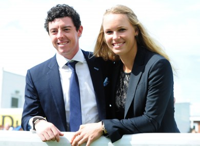 No rush: Rory McIlroy and Caroline Wozniacki. (File picture)