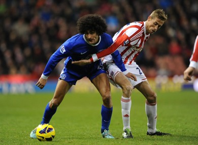 Stoke City's Peter Crouch (right) and Everton's Marouane Fellaini battle for the ball in todays' match.