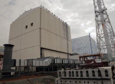 The unit No.1 reactor building, left, and No. 2 of the crippled Fukushima Dai-ichi Nuclear power plant