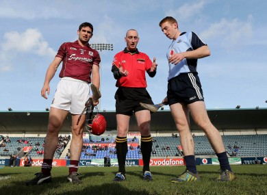 Dublin's John McCaffrey and Fergal Moore of Galway at the coin toss
