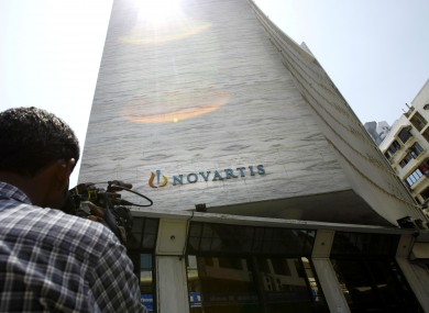 A cameraman films the head office of Novartis India Limited in Mumbai, India