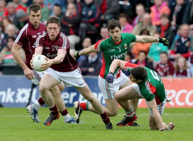 Mayo's Ger Cafferkey and Lee Keegan with Conor Doherty of Galway.