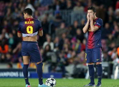 Barcelona's Alexis Sanchez and David Villa stand dejected after Bayern Munich's third goal.
