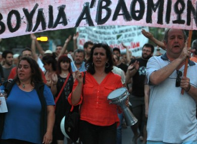 Protesters shout slogans during a protest in solidarity to the employees of Greek state broadcaster, ERT, in Thessaloniki.