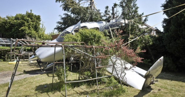PHOTOS: Plane crashes into someone's back garden – and somehow, nobody is injured