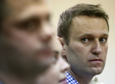 Russian opposition leader Alexei Navalny, right, listens to the judge while attending his trial at a court in Kirov, Russia