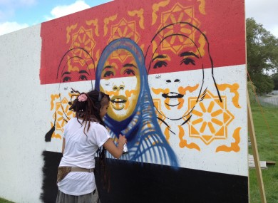 Mexican artist Kathrina Rupit works on the mural earlier this week.