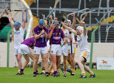 Antrim players celebrate at the final whistle in Thurles yesterday.