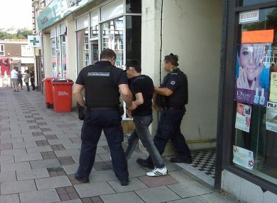 A suspected visa overstayer is arrested at a nail bar in Swansea, Wales