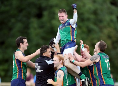 Warriors' Mark Leavy celebrates with teammates after the game.