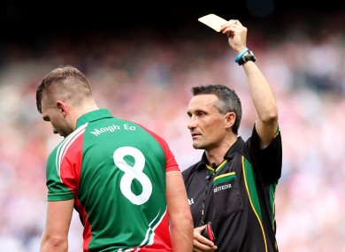 Referee Maurice Deegan yellow cards Aidan O'Shea yesterday in Croke Park.