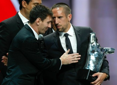 Lionel Messi congratulates Franck Ribery on his European Player of 2012/13 award.