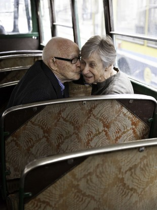 Bill Short steals a kiss from wife Norrie on a vintage CIE Tour bus.