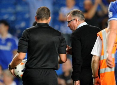Aston Villa Manager Paul Lambert speaks to referee Kevin Friend after the defeat to Chelsea.