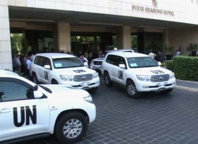 UN vehicles at a hotel after UN weapons inspectors arrive in Damascus.